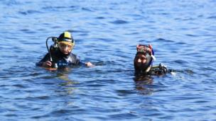 Jamie and his dad go scuba diving