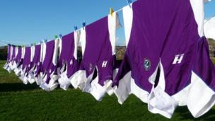 Rugby shirts on a washing line