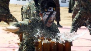South Korean soldier breaks beer bottles (13 September 2013)