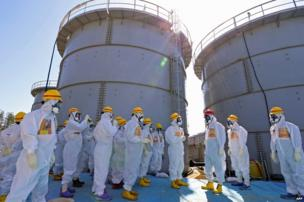 Japanese Prime Minister Shinzo Abe (red hat) at the Fukushima Daiichi nuclear plant