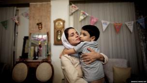 Iranian lawyer Nasrin Sotoudeh hugs son Nima