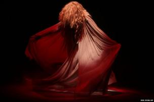 Model Lily Cole performs a dance ahead of the show by Vivienne Westwood during London Fashion Week