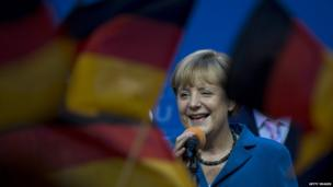 Angela Merkel surrounded by Germany flags