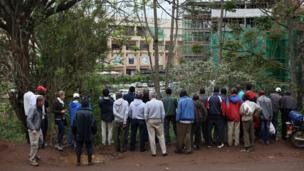 Residents look at the military rescue operation at the Westgate shopping centre in the capital Nairobi,