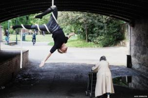 A man hanging upside down from a rope