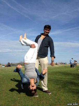 Man holding woman upside down