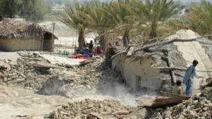 Collapsed homes in Awaran district on 25 September 2013