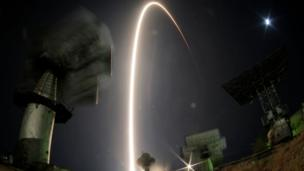 In this photo taken with a fisheye lens and with long time exposure the Soyuz-FG rocket booster with Soyuz TMA-10M space ship carrying a new crew to the International Space Station, ISS, blasts off at the Russian leased Baikonur cosmodrome, Kazakhstan