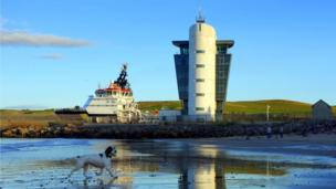 Boat by Aberdeen harbour control tower