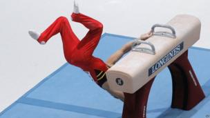 Gymnast Daan Kenis from Belgium falls off the pommel horse, during the qualification round at the artistic gymnastics World Championships in Antwerp, Belgium