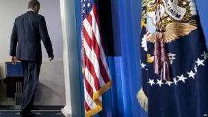 US President Barack Obama leaves after speaking about the possible government shutdown during a budget showdown with Congress in the Brady Press Briefing Room of the White House in Washington, DC, 30 September, 2013.