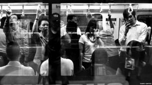 Rush hour on Singapore's underground subway.