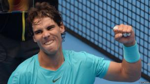 Rafael Nadal of Spain celebrates after winning his men's singles quarter-finals match against Fabio Fognini of Italy at the China Open tennis tournament in Beijing on 4 October 2013.
