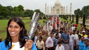 Indian athlete Sudha Singh holds the Commonwealth Games Queen Baton