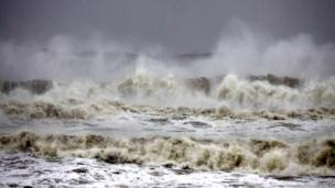 High tide waves approach the Bay of Bengal coast near Gopalpur beach in Ganjam district on 12 October
