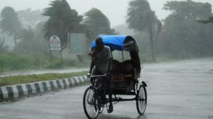 A rickshaw man bikes through heavy rain in Berhampur, about 180 kilometres south from eastern city Bhubaneswar