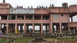 Villagers take refuge in a cyclone shelter at Gokhorkuda village in, Ganjam district
