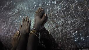 Muslim pilgrims touch a rock as they pray on Mount Arafat, near the holy city of Mecca