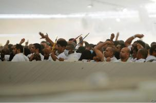 "Muslim pilgrims throw pebbles at pillars during the ""Jamarat"" ritual - the Stoning of the Devil - in Mina near the holy city of Mecca."