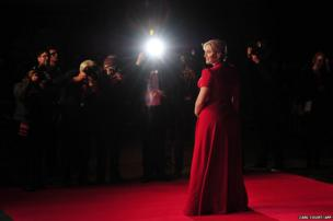 British actress Kate Winslet poses for pictures at the gala premiere of the film Labour Day in London's Leicester Square