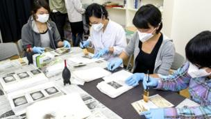 Volunteers restoring photographs