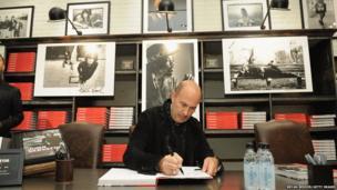 Photographer John Varvatos signs his new book