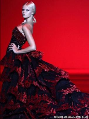 A model showcases designs by Michael Cinco on the catwalk in Singapore