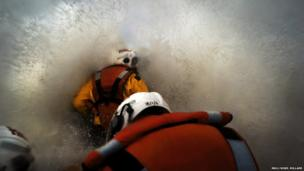 Crew are hit by a wave