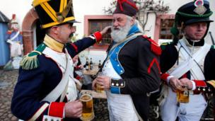 Battle of Leipzig re-enactors drink beer at a bivouac camp (19 October)