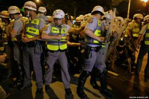 Military policemen arrest demonstrators during a protest against Sao Paulo's education system