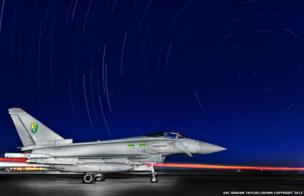 A Typhoon aircraft under a starlit sky in the Middle-East during a multi-national training exercise