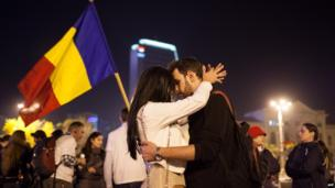Two protesters share a moment of intimacy outside the Romanian government's headquarters during a rally in Bucharest against the Rosia Montana Gold Corporation (RMGC), on 27 October 2013.
