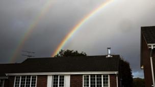 A double rainbow appears following a rain shower over houses in Hartley Wintney, in Hampshire (28 October 2013)