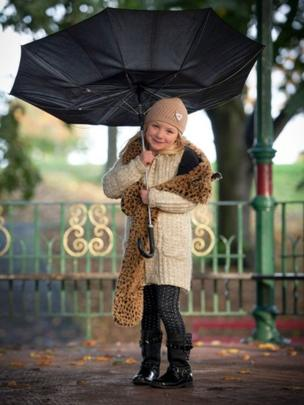 Still stormy weather, Craig MacDougall from Wrexham sent in this photo of his daughter fighting off the rain and the wind