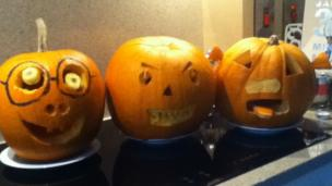 Carved pumpkins in a row