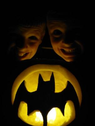 Murray and Euan with a carved pumpkin