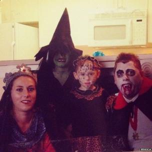 Children and adults in a selection of different Halloween costumes.