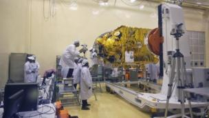 Indian scientists and engineers work with their staff on the Mars orbiter spacecraft at the satellite centre of Indian Space Research Organization (ISRO) in Bangalore