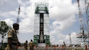 Paramilitary soldiers stand guard near the Polar Satellite Launch Vehicle (PSLV-C25) at the Satish Dhawan Space Center at Sriharikota, in the southern Indian state of Andhra Pradesh
