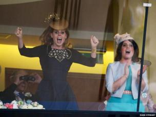 Princesses Beatrice and Eugenie cheer The Queen's horse Estimate onto victory in the Gold Cup at Royal Ascot