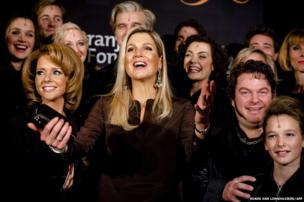 Dutch Queen Maxima (centre) poses with the cast of the musical Hij Gelooft in Mij (He Believes in Me), after a benefit performance in Amsterdam