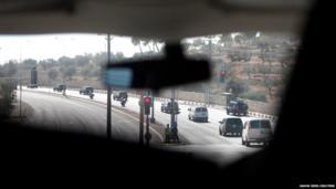 US Secretary of State John Kerry's motorcade travels through the streets of Jerusalem