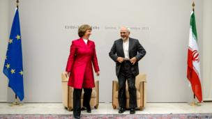 EU foreign policy chief Catherine Ashton speaks with Iranian Foreign Minister Mohammad Javad Zarif in Geneva