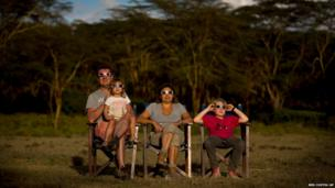 Belgian tourists watch a hybrid solar eclipse from Lake Oloidien in Kenya
