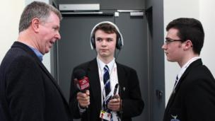 Former Turner prize nominee and former St Columb's College pupil Willie Doherty speaks to Eoghan (middle) and David.