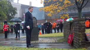 "Secretary of State for Wales David Jones lays a wreath at the Royal Mint""s war memorial in Llantrisant, Wales."
