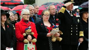 Dorothy Bernall, 54 (2nd left) and Sally Clough, 29 (3rd right) during Armistice Day commemorations at the Armed Forces Memorial, National Memorial Arboretum, Alrewas, Staffordshire