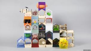 A dolls' house made up of lots of little dolls' houses
