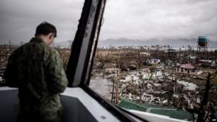 A Filipino soldier stands in the damaged control tower of the airport in Tacloban, on the eastern island of Leyte