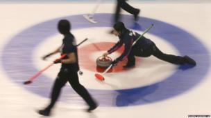 Japan's Yumie Funayama releases a stone during a curling match